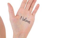 Ręka pokazuje słowa wierzę Zdjęcia Stock