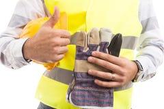 Ręka pracownika budowlanego trzymać i kciuka showking glov Obrazy Royalty Free