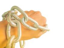 Ręka przykuwająca z żelazo łańcuchem, odosobnionym na białym tle Fotografia Stock