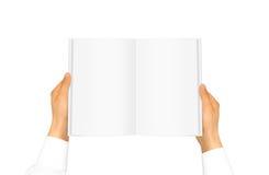 Ręka rękawa mienia biała koszulowa książka Zdjęcia Stock