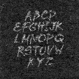 Ręka rysująca chrzcielnica na textured papierowym czarnym tle Zdjęcia Royalty Free