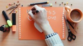 Ręka rysujący czasu upływ ręki writing zwrota walentynek Szczęśliwy dzień i tnący serce od papieru Fotografii sekwenci animacja zbiory
