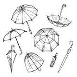 Ręka rysujący parasole ustawiający royalty ilustracja