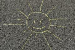 Ręka rysujący słońce na drodze Obrazy Stock