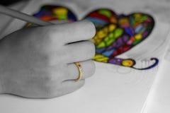 Ręka rysuje kolorowego tęcza motyla Obrazy Stock
