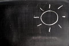 Ręka rysunek biel kreda w słońce kształcie z kopii przestrzenią fotografia stock