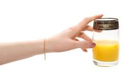 ręka sięga sok Zdjęcie Stock