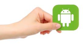Ręka trzyma android ikonę Fotografia Royalty Free