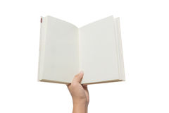 Ręka trzyma białą książkę na bielu Zdjęcia Stock