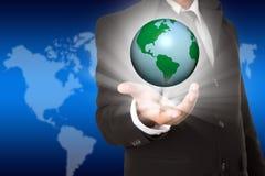 Ręka trzyma biznesowego świat Zdjęcia Stock