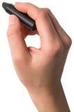 Ręka trzyma czarną kredkę Zdjęcie Stock