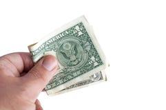 Ręka trzyma fałdowego dolara Fotografia Royalty Free