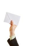 Ręka trzyma kopertę Obrazy Stock