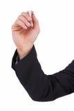 Ręka trzyma kredę i pisze coś Fotografia Royalty Free