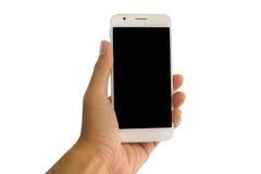 Ręka trzyma mądrze telefon na odosobnionym Obrazy Royalty Free