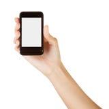 Ręka trzyma mądrze telefon odizolowywający na bielu Fotografia Royalty Free