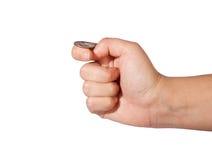 Ręka trzyma monetę Zdjęcia Royalty Free