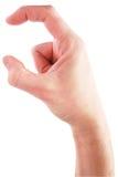Ręka trzyma niewidzialną rzecz - Akcyjny wizerunek zdjęcie royalty free