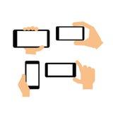 Ręka trzyma nowożytnego przyrząd Zdjęcia Stock