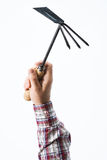 Ręka trzyma ogrodnictwo motykę Obraz Royalty Free