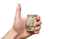 Ręka trzyma pięćdziesiąt dolarową rolkę zdjęcia stock