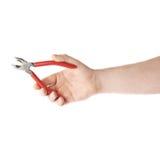 Ręka trzyma plier narzędzie, skład odizolowywający nad białym tłem Obrazy Royalty Free