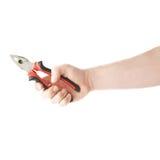 Ręka trzyma plier narzędzie, skład odizolowywający nad białym tłem Zdjęcie Royalty Free