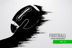 Ręka trzyma rugby piłkę, sylwetka również zwrócić corel ilustracji wektora Zdjęcia Royalty Free