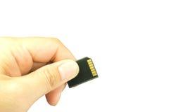 Ręka trzyma sd pamięci kartę Obrazy Stock