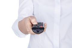 Ręka trzyma tv pilot do tv z ciałem odizolowywającym na białym backg Fotografia Stock