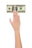 Ręka trzyma wiązkę $100 rachunków Zdjęcia Stock