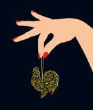 Ręka trzyma złocistego koguta Zdjęcie Royalty Free