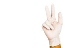 Ręka w chirurgicznie lateksowym rękawiczkowym gescie liczba Osiem Zdjęcie Stock