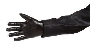 Ręka w czarnej rzemiennej rękawiczce i czarnym kostiumu Zdjęcia Royalty Free