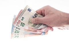 Ręka wręcza nad różnymi euro rachunkami męska osoba obrazy stock