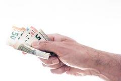 Ręka wręcza nad różnymi euro rachunkami męska osoba obrazy royalty free