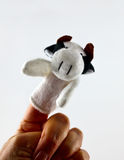 Ręka z krowa palca kukłą Fotografia Stock