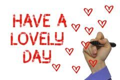 Ręka z markierem pisze słowie Uroczego dzień Obraz Royalty Free