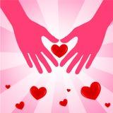 Ręka z miłości sercem na różowym tle. Fotografia Stock
