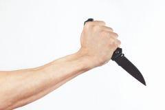 Ręka z nożem na białym tle Zdjęcia Stock