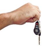 Ręka z nowymi samochodowymi kluczami odizolowywającymi na biel fotografia royalty free