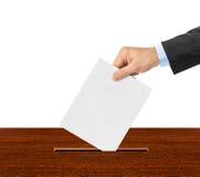 Ręka z papierowym tajnym głosowaniem Zdjęcia Royalty Free