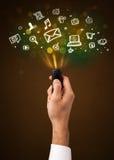 Ręka z pilot do tv i socjalny środków ikonami Zdjęcia Stock