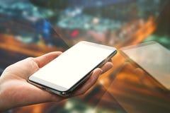 Ręka z pustym białym smartphone zdjęcie stock