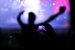 Ręka z smartphone nagrywa żywego koncert Zdjęcia Stock