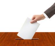 Ręka z tajnym głosowaniem i pudełkiem Zdjęcia Stock