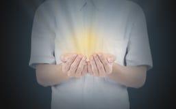 Ręka z złota światłem zdjęcia stock