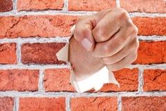 Ręki łamanie przez ściany fotografia royalty free