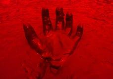 Ręki czerwień w borowinowym tle Obraz Royalty Free