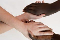 Ręki dziewczyna biała i inny kolor Fotografia Stock